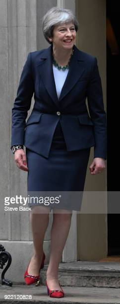 British Prime Minister Theresa May walks to greet Prime Minister of the Netherlands Mark Rutte outside Downing Street on February 21 2018 in London...