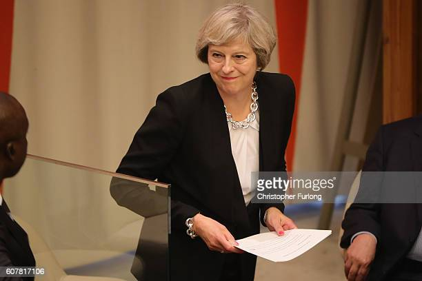 British Prime Minister Theresa May walks to the podium to address delegates with her keynote speech on the refugee crisis at the United Nations...