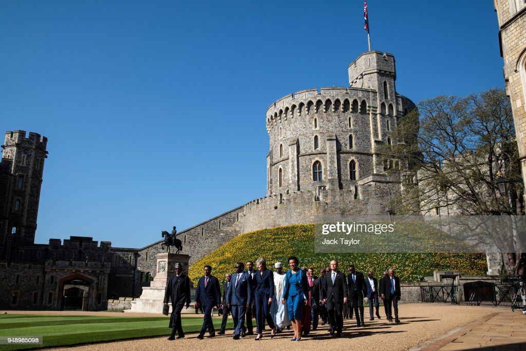 British Prime Minister Theresa May walks with commonwealth leaders as they arrive at Windsor Castle for a retreat on the final day of the 'Commonwealth Heads of Government Meeting' (CHOGM) on April 20, 2018 in Windsor, England. The UK is hosting the heads of state and government from the Commonwealth nations this week.