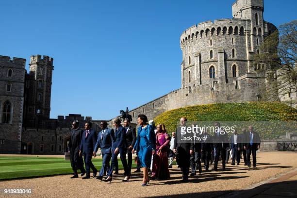 British Prime Minister Theresa May walks with commonwealth leaders as they arrive at Windsor Castle for a retreat on the final day of the...