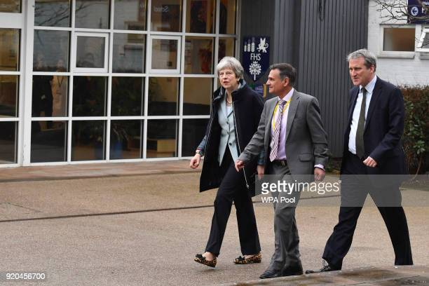 British Prime Minister Theresa May walks with headteacher Gerry Wadwa during her visit to Featherstone High School in Southall on February 19 2018 in...