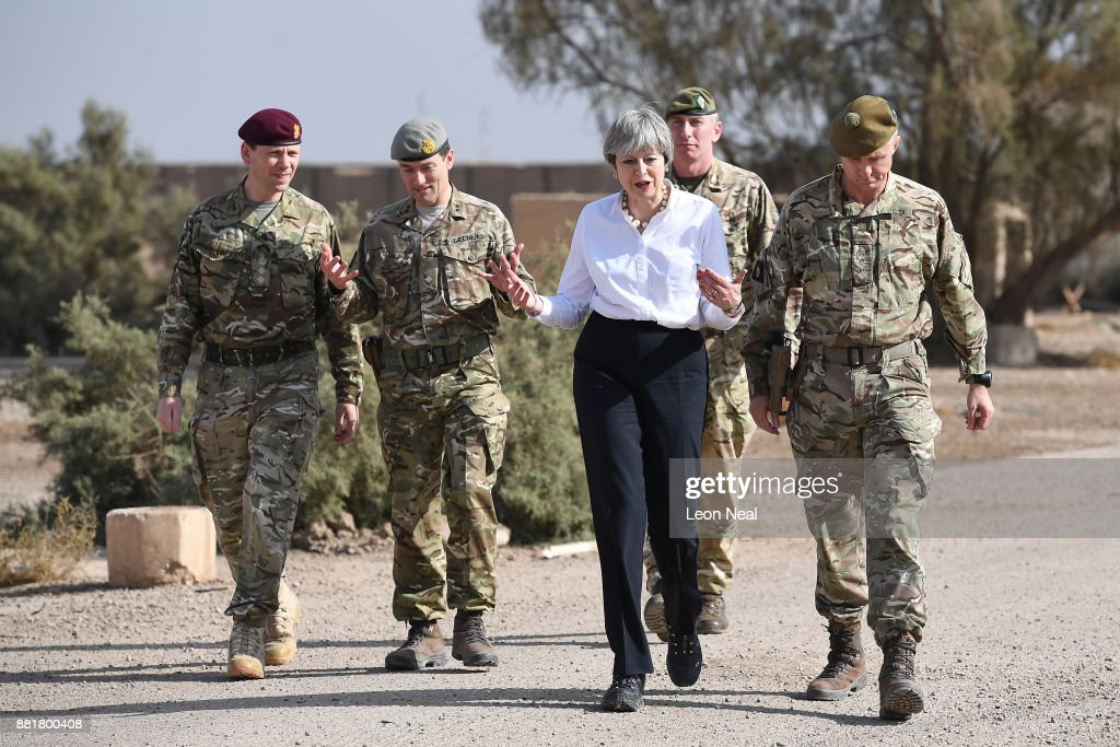 British Prime Minister Theresa May (C) walks with soldiers at the Camp Taji military base on November 29, 2017 in Taji, Iraq. Theresa May has made a surprise visit to Iraq during a planned visit to the Middle East.