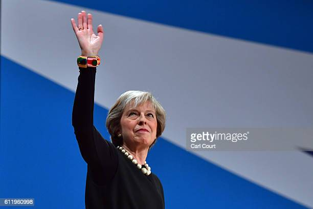 British Prime Minister Theresa May waves after delivering a speech about Brexit on the first day of the Conservative Party Conference 2016 at the ICC...