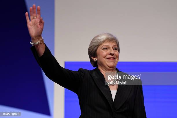 British Prime Minister Theresa May waves after delivering her leader's speech during the final day of the Conservative Party Conference at The...