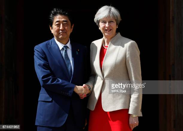 British Prime Minister Theresa May welcomes Prime Minister Shinzo Abe of Japan the Prime Minister's country retreat Chequers on April 28 2017 near...