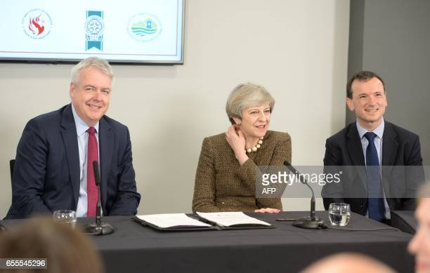 British Prime Minister Theresa May Welsh First Minister Carwyn Jones and British Wales Secretary Alun Cairns are pictured during a bilateral meeting...
