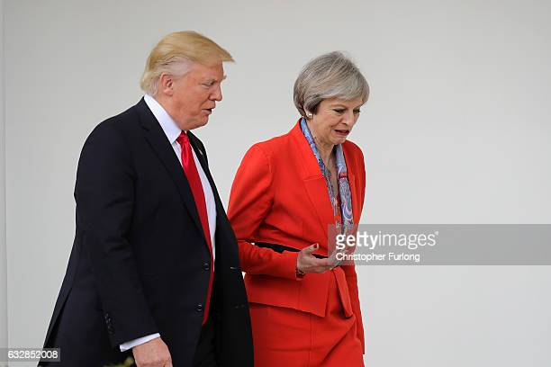 British Prime Minister Theresa May with US President Donald Trump walk along The Colonnade at The White House on January 27 2017 in Washington DC...