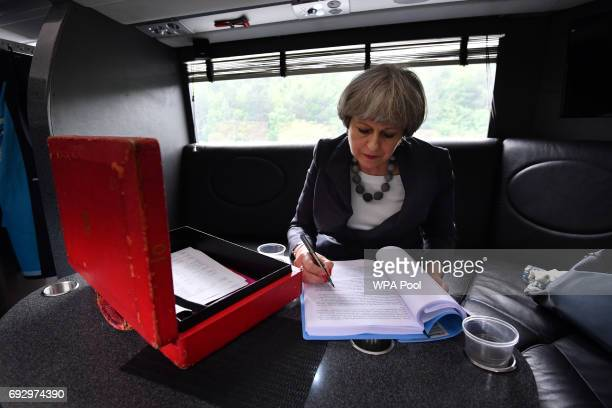 British Prime Minister Theresa May works on the election campaign bus commonly known as the 'Battle Bus' as it travels through Staffordshire on June...