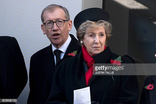 British Prime Minister Theresa May's husband Philip and former British Prime Minister John Mayor's wife Norma watch the Remembrance Sunday ceremony...
