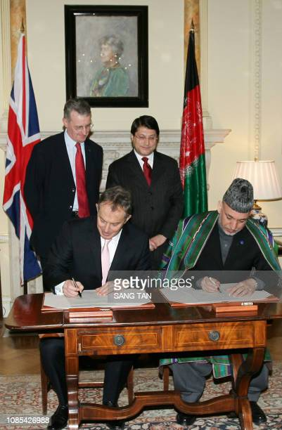 British Prime Minister Tony Blair and Afhgan President Hamid Karzai sign a bilateral agreement on the future of Afghanistan at 10 Downing Street in...
