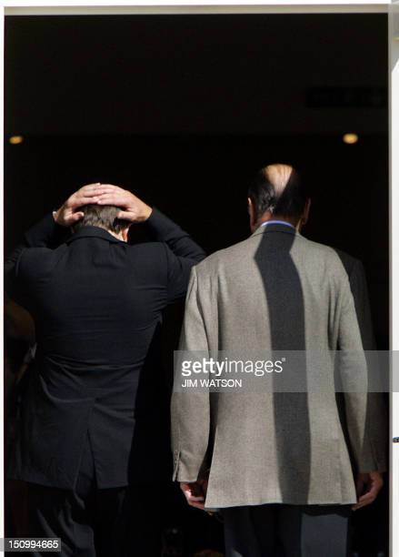 British Prime Minister Tony Blair and French President Jacques Chirac enter Gleneagles hotel for the first working session of a G8 summit 07 July...