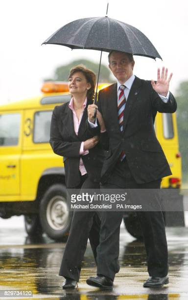 British Prime Minister Tony Blair and his wife Cherie arrive where they will be whisked away by helicopter for the start of the G8 Summit at...