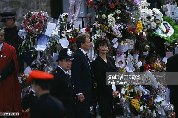 British Prime Minister Tony Blair and his wife Cherie stand at the funeral of Diana Princess of Wales only seven days after she was killed in an...