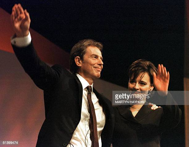 British Prime Minister Tony Blair and his wife Cherie wave 28 September 1999 after his address at the Labor Party's annual conference in Bournemouth,...