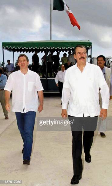 British Prime Minister Tony Blair and Mexican President Vicente Fox visit 03 August 2001 the facilities of the Cantarell Oilfield one of the world's...