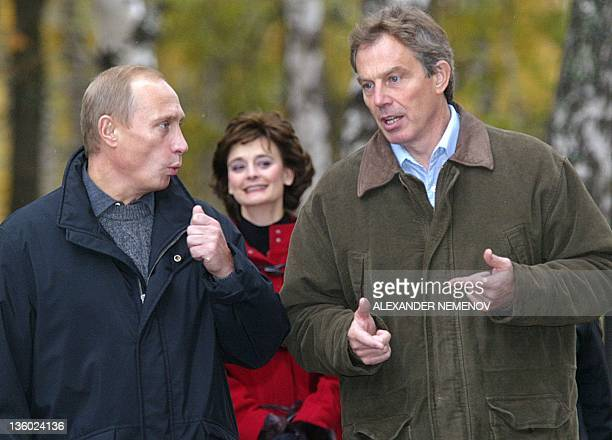 British Prime Minister Tony Blair and Russian President Vladimir Putin discuss as they walk in the residence of Zavidovo , in the Tver region, some...