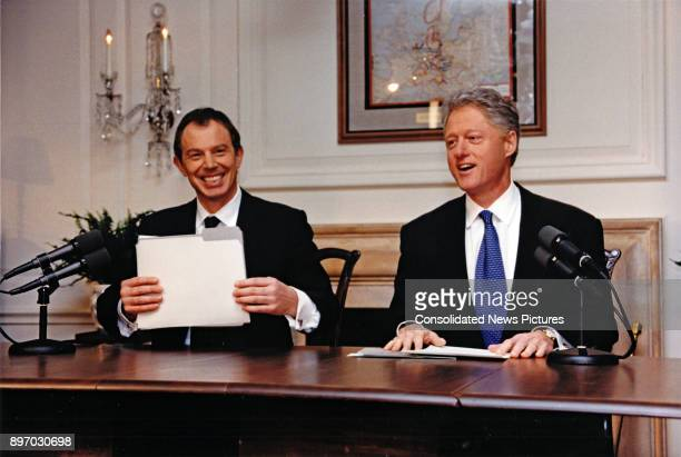 British Prime Minister Tony Blair and US President Bill Clinton share a laugh together as they deliver a joint radio address from the White House...