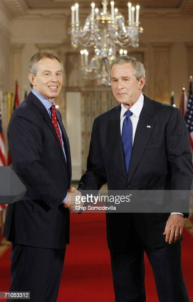 British Prime Minister Tony Blair and US President George W Bush shake hands after holding a joint news conference in the East Room of the White...