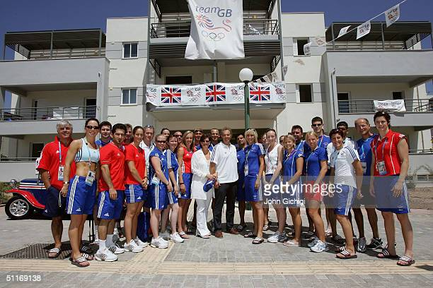 British Prime Minister Tony Blair and wife Cherie pose for a photograph with athletes during their visit to the Team GB residence at the Athletes...