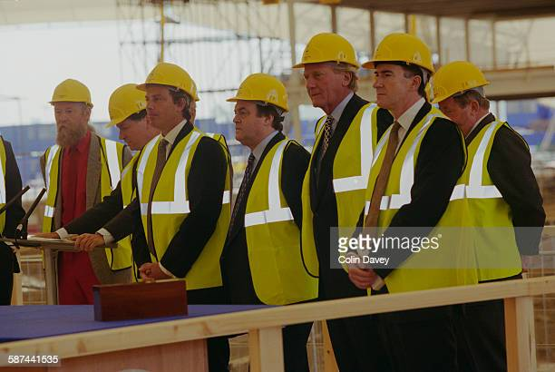 British Prime Minister Tony Blair attends the builder's rite of 'topping out' as the Millennium Dome reaches completion, London, 22nd June 1998. With...
