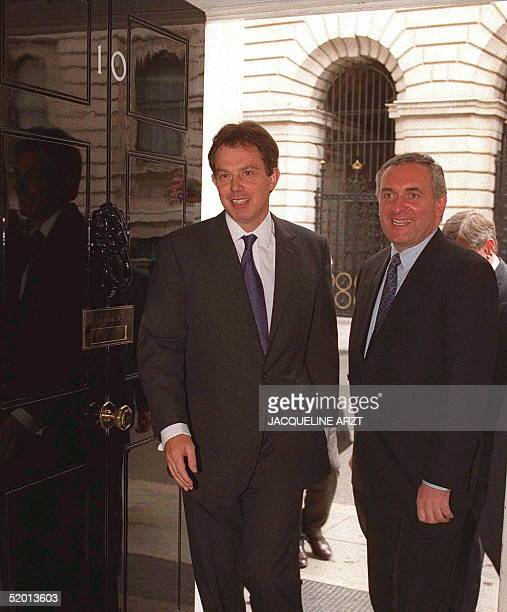 British Prime MInister Tony Blair enters 10 Downing St his official residence with the newlyelected Irish Prime Minster Bertie Ahern for talks in...