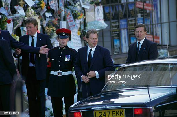 British Prime Minister Tony Blair gets out of an automobile at the funeral of Diana Princess of Wales only seven days after she was killed in an...