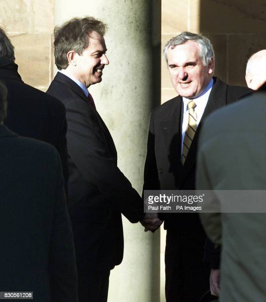British Prime Minister Tony Blair greets Irish Premier Bertie Ahern at Hillsborough Castle County Down Mr Blair flew into the province as the IRA...