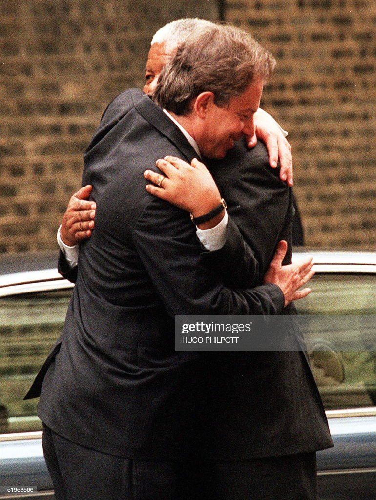 British Prime Minister Tony Blair greets the former South African President Nelson Mandela affectionately outside No10 Downing St, London May 3 2000. Mr Mandela is in talks with the Prime Minister centering around the peace process in Burundi.