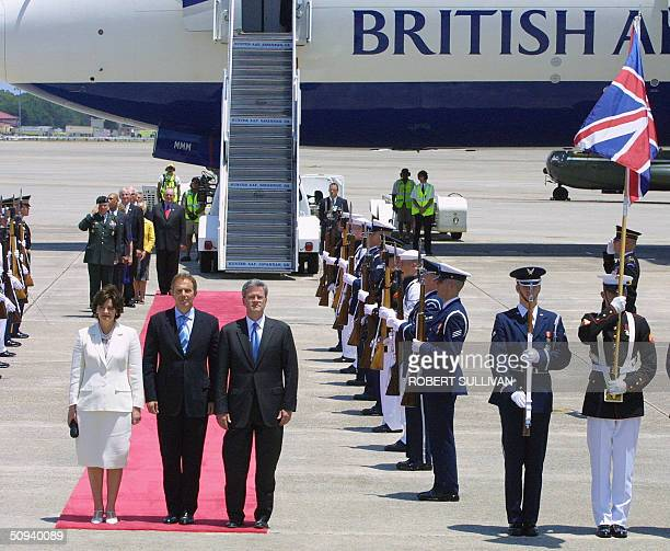 British Prime Minister Tony Blair his wife Cherie and Deputy US Chief of Protocol Jeff Eubank stand on the red carpet next to the Honor Guard during...