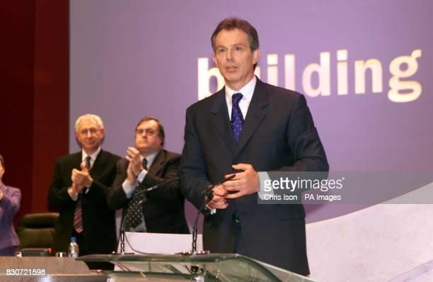 British Prime Minister Tony Blair is applauded by Deputy leader John Prescott and General Secretary David Triesman after giving his keynote speech at...