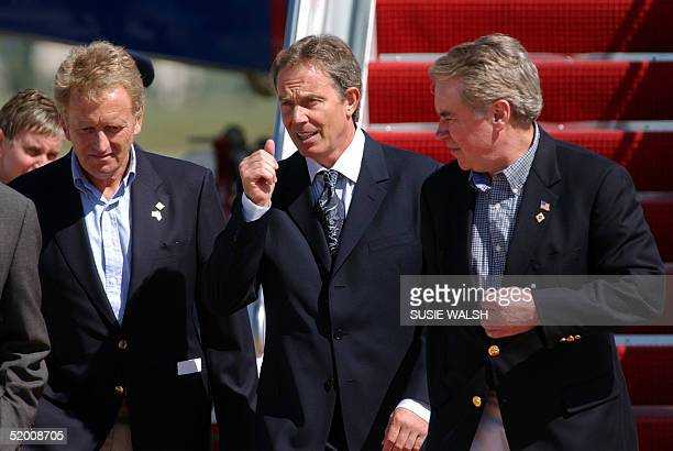 British Prime Minister Tony Blair is flanked by British Ambassador to the US Christopher Meyer and US Chief of Protocol Donald Ensenat on his arrival...
