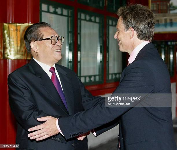 British Prime Minister Tony Blair is greeted by China's Central Military Commission Chairman and former president Jiang Zemin at the Zhongnanhai...