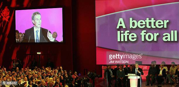 British Prime Minister Tony Blair is projected on a big screen TV as he delivers his keynote speech 28 September 2004 at the Brighton Conference...