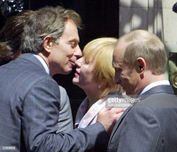 British Prime Minister Tony Blair kisses Ludmila wife of Russian President Vladimir Putin during the meeting at Downing street 10 in London 26 June...