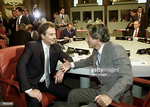 British Prime Minister Tony Blair left and Japanese Prime Minister Junichiro Koizumi talk July 21 2001 at the G8 summit in Genoa Italy The summit was...