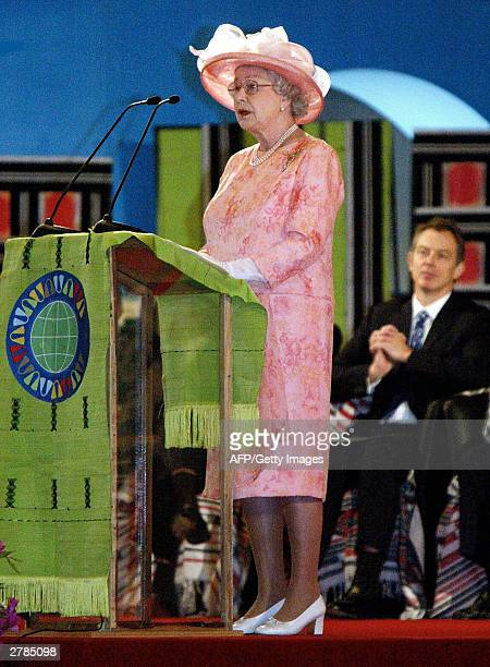 British Prime Minister Tony Blair listens to Britain's Queen Elizabeth II holding a speech during the opening ceremony of the Commonwealth heads of...