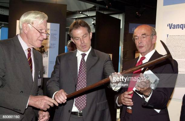 British Prime Minister Tony Blair looks at pick used by George Mallory on Mount Everest with George Band and Jim Smith from the exhibition at Rheged...