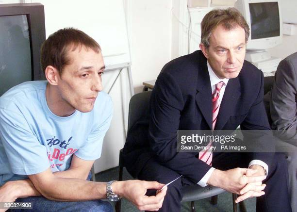 British Prime Minister Tony Blair meets Youth worker Darren Jakobsen during a visit to an anger management class at Tower Hamlets Referral Unit in...