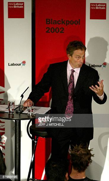 British Prime Minister Tony Blair participates in a question and answer session with conference delegates in a Blackpool nightclub during the annual...