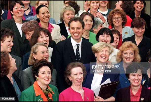 British Prime Minister Tony Blair poses for the cameras 07 May with some of the 100 new Labour women MP's on the sixth day of the new Labour...
