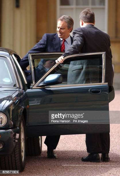 British Prime Minister Tony Blair rides in a car as he leaves Buckingham Palace after an audience with Britain's Queen Elizabeth II in which he asked...