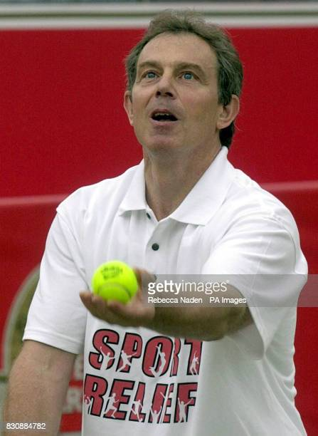 British Prime Minister Tony Blair serving the ball during a tennis match for Sport Relief at the Stella Artois Championships in Queen's Club London *...