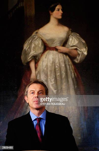 British Prime Minister Tony Blair stands in front of Augusta Ada Byron Countess of Lovelace by Margaret Carpenter during a press conference at...