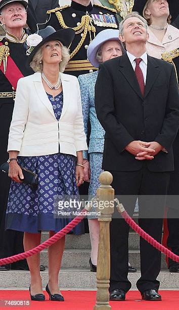 British Prime Minister Tony Blair stands with Camilla Duchess of Cornwall during a Falklands War flypast on June 17 2007 in London Commemorations to...