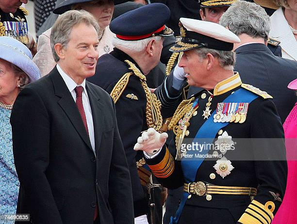 British Prime Minister Tony Blair stands with Prince Charles Prince of Wales during a Falklands War flypast on June 17 2007 in London Commemorations...