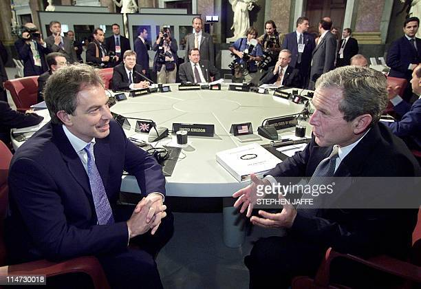 British Prime Minister Tony Blair talks to US President George W. Bush at the beginning of the their first working session of the G8 meeting...