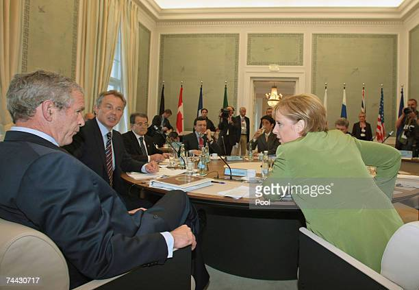 British Prime Minister Tony Blair US President George W Bush and German Chancellor Angela Merkel talk before a meeting during the first day of the G8...