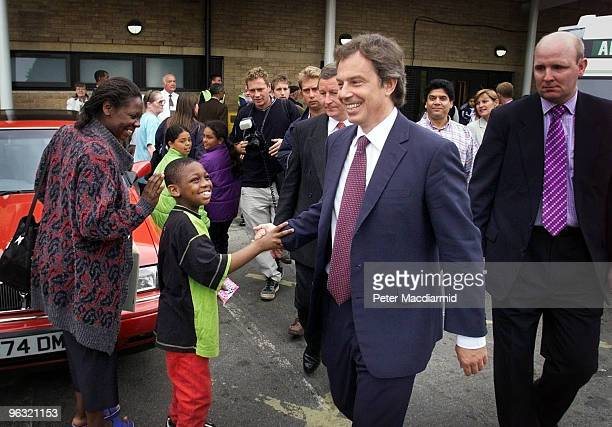 British Prime Minister Tony Blair visits Homerton Hospital in Hackney London 26th July 1999 The PM is greeted by a small boy as he leaves the hospital