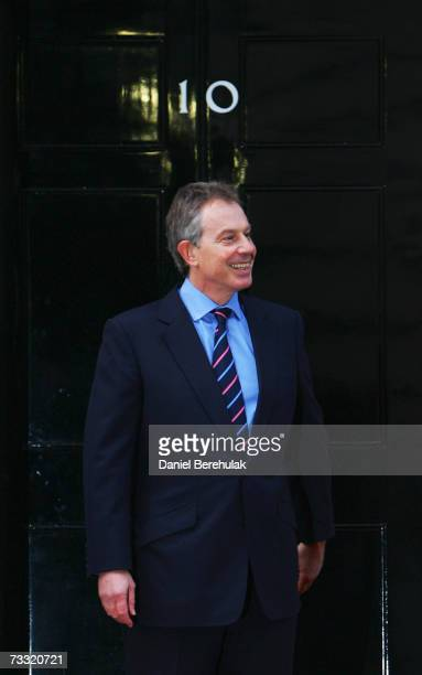 British Prime Minister Tony Blair waits on the doorstep before meeting with Afghanistan President Hamid Karzai outside his Downing St residence on...