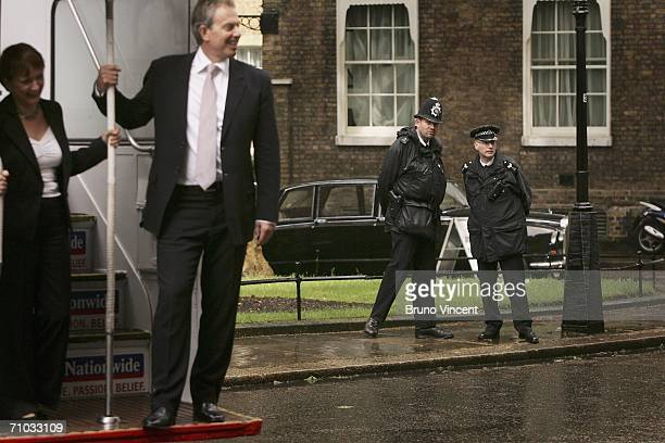British Prime Minister Tony Blair watched by police officers poses with Secretary of State for Culture Media and Sport Tessa Jowell on an opentop...